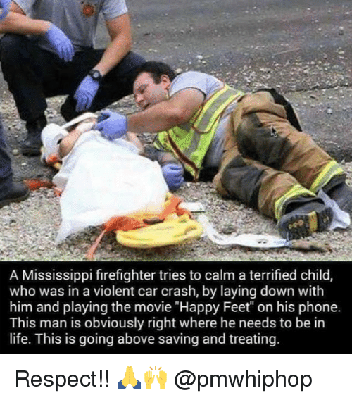 """Car Crashing: A Mississippi firefighter tries to calm a terrified child,  who was in a violent car crash, by laying down with  him and playing the movie """"Happy Feet"""" on his phone.  This man is obviously right where he needs to be in  life. This is going above saving and treating Respect!! 🙏🙌 @pmwhiphop"""
