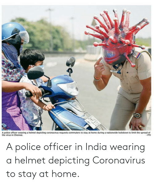 Stay At Home: A police officer in India wearing a helmet depicting Coronavirus to stay at home.