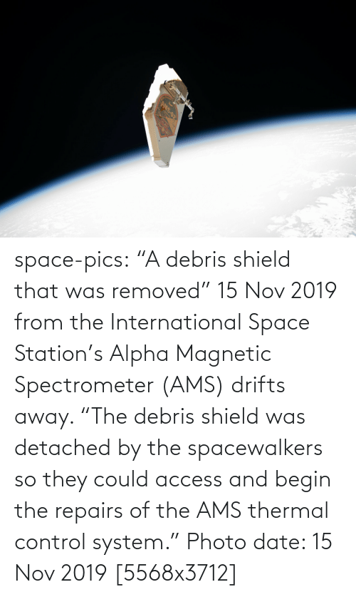 "Access: AMS-02 space-pics:  ""A debris shield that was removed"" 15 Nov 2019 from the International Space Station's Alpha Magnetic Spectrometer (AMS) drifts away. ""The debris shield was detached by the spacewalkers so they could access and begin the repairs of the AMS thermal control system."" Photo date: 15 Nov 2019 [5568x3712]"
