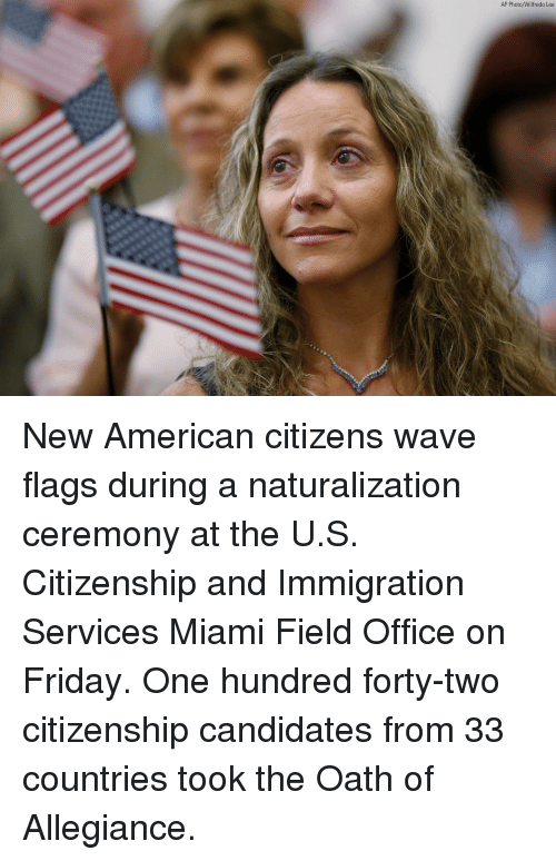 Friday, Memes, and American: AP Photo/Wilfredo Lee New American citizens wave flags during a naturalization ceremony at the U.S. Citizenship and Immigration Services Miami Field Office on Friday. One hundred forty-two citizenship candidates from 33 countries took the Oath of Allegiance.