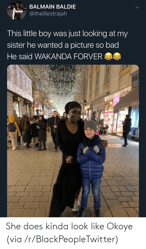 boy: BALMAIN BALDIE  @theillestrajah  This little boy was just looking at my  sister he wanted a picture so bad  He said WAKANDA FORVER AS  WEINDL  ANZA She does kinda look like Okoye (via /r/BlackPeopleTwitter)