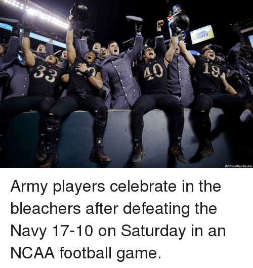Ncaa: BUD  LIGHT  40  (AP Photo/Matt Rourke) Army players celebrate in the bleachers after defeating the Navy 17-10 on Saturday in an NCAA football game.