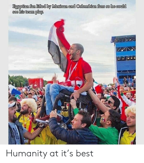 Lifted: Egyptian fan lifted by Mexican and Colombian fans so he could  see his team play. Humanity at it's best