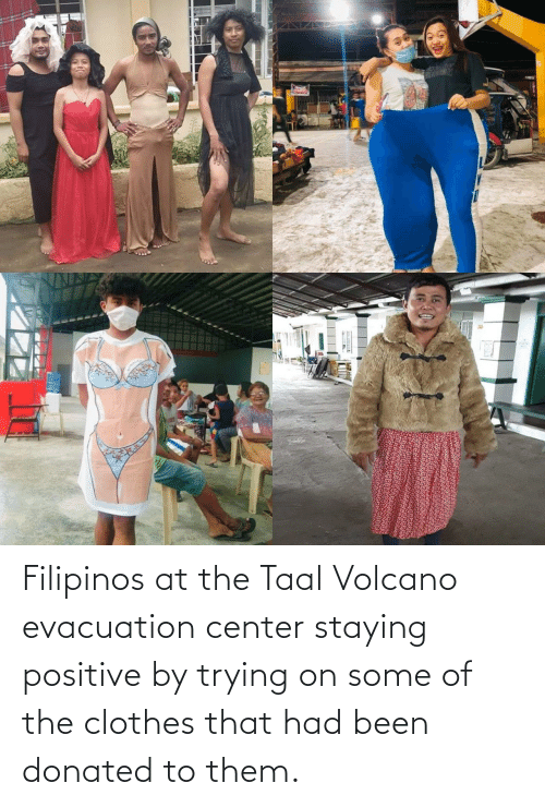 At: Filipinos at the Taal Volcano evacuation center staying positive by trying on some of the clothes that had been donated to them.