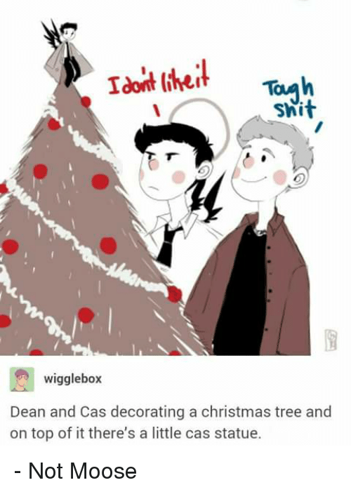 christmas trees: Idoit theit  Swit  wigglebox  Dean and Cas decorating a christmas tree and  on top of it there's a little cas statue. - Not Moose