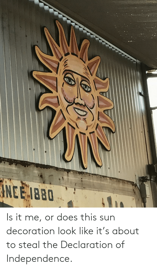 Look Like: Is it me, or does this sun decoration look like it's about to steal the Declaration of Independence.