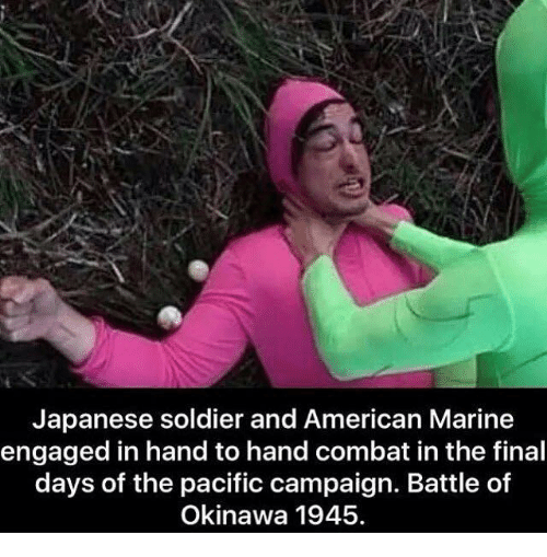 Handness: Japanese soldier and American Marine  engaged in hand to hand combat in the final  days of the pacific campaign. Battle of  Okinawa 1945.