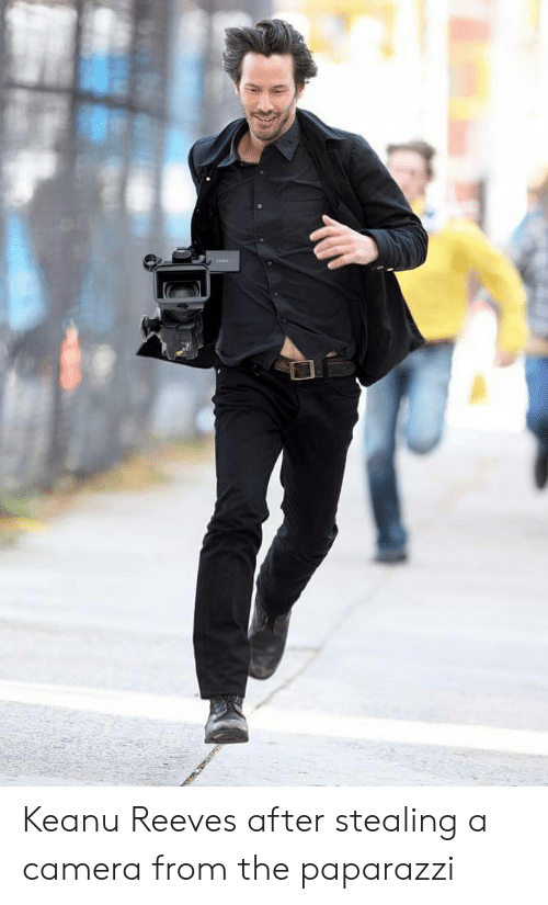 Stealing A: Keanu Reeves after stealing a camera from the paparazzi