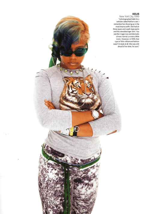"Showing: KELIS  New York City, 1999  ""I photographed Kelis for a  website called Platform.net. I  remember her showing up in the  most insane outfit. She had on  these quasi-acid-wash-type pants  and this shredded tiger shirt. You  see the image now and she looks  almost normal, or even a little  ironic. However, in 1999, that  type of '80s-influenced fashion  wasn't in style at all. She was a bit  ahead of her time, for sure."""
