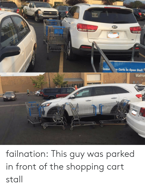 carts: KIA  lease  Carts In Open Stall  Walma failnation:  This guy was parked in front of the shopping cart stall