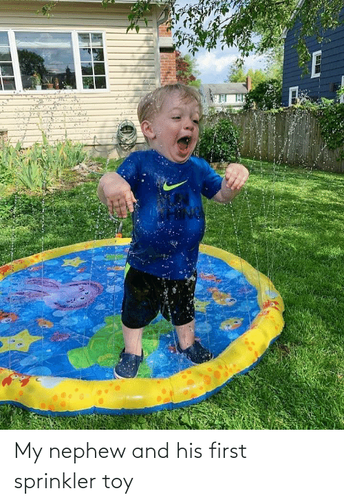 His: My nephew and his first sprinkler toy