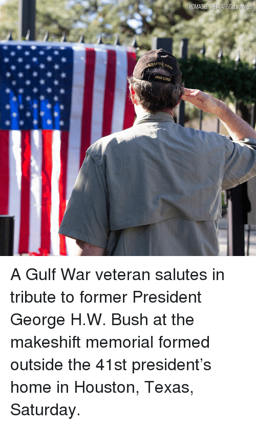 Memes, Home, and Houston: oarm A Gulf War veteran salutes in tribute to former President George H.W. Bush at the makeshift memorial formed outside the 41st president's home in Houston, Texas, Saturday.