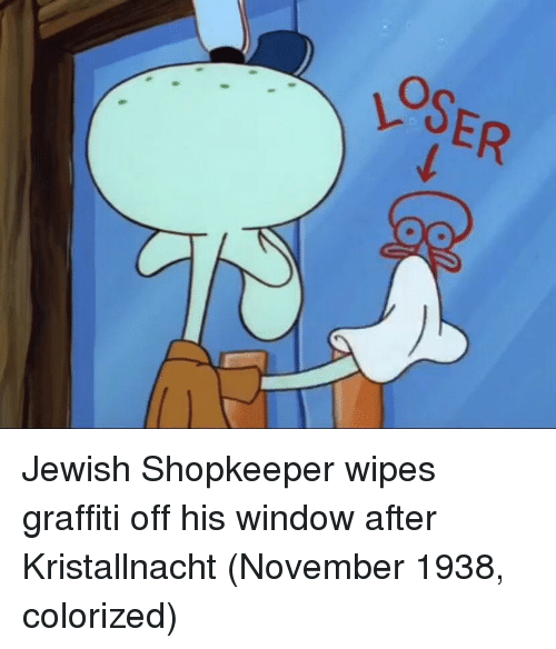Graffiti, Jewish, and Window: OSER Jewish Shopkeeper wipes graffiti off his window after Kristallnacht (November 1938, colorized)