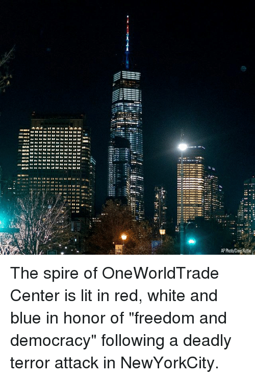 "Blue In: P Photo/Crag Ruttle The spire of OneWorldTrade Center is lit in red, white and blue in honor of ""freedom and democracy"" following a deadly terror attack in NewYorkCity."