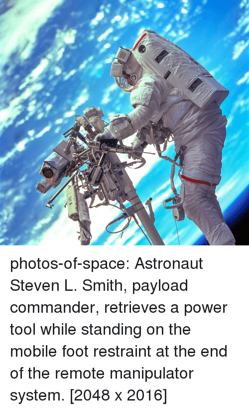 Tumblr, Blog, and Mobile: photos-of-space:  Astronaut Steven L. Smith, payload commander, retrieves a power tool while standing on the mobile foot restraint at the end of the remote manipulator system. [2048 x 2016]