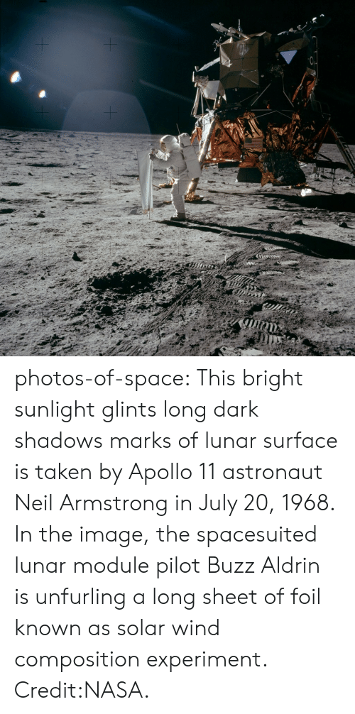 armstrong: photos-of-space:  This bright sunlight glints  long dark shadows marks of lunar surface is taken by Apollo 11 astronaut Neil Armstrong in July 20, 1968. In the image, the spacesuited lunar module pilot Buzz Aldrin is unfurling a long sheet of foil known as solar wind composition experiment. Credit:NASA.
