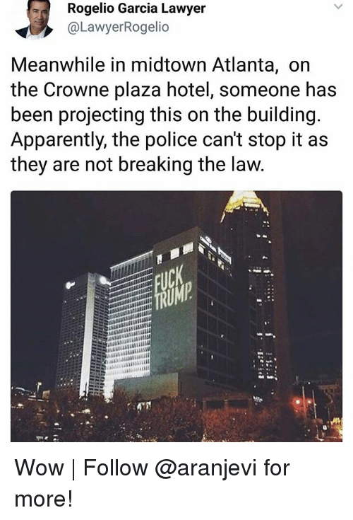 Projecting: Rogelio Garcia Lawyer  @LawyerRogelio  Meanwhile in midtown Atlanta, on  the Crowne plaza hotel, someone has  been projecting this on the building  Apparently, the police can't stop it as  they are not breaking the law Wow | Follow @aranjevi for more!