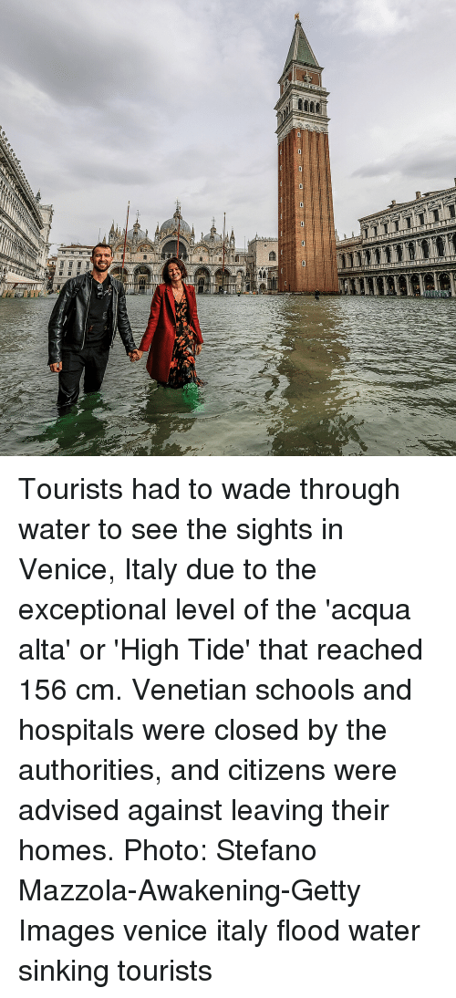 Sights: Tourists had to wade through water to see the sights in Venice, Italy due to the exceptional level of the 'acqua alta' or 'High Tide' that reached 156 cm. Venetian schools and hospitals were closed by the authorities, and citizens were advised against leaving their homes. Photo: Stefano Mazzola-Awakening-Getty Images venice italy flood water sinking tourists